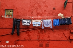 Laundry on Red Wall